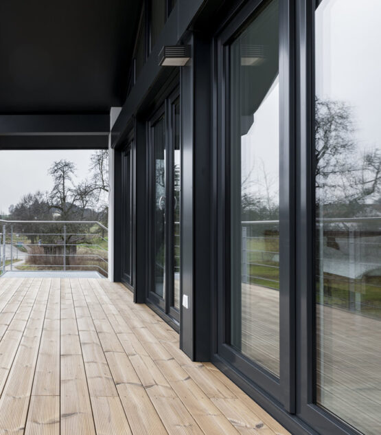covered porch with composite material black trim